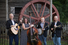 The Hunt Family Band in front of a mill - horizontal